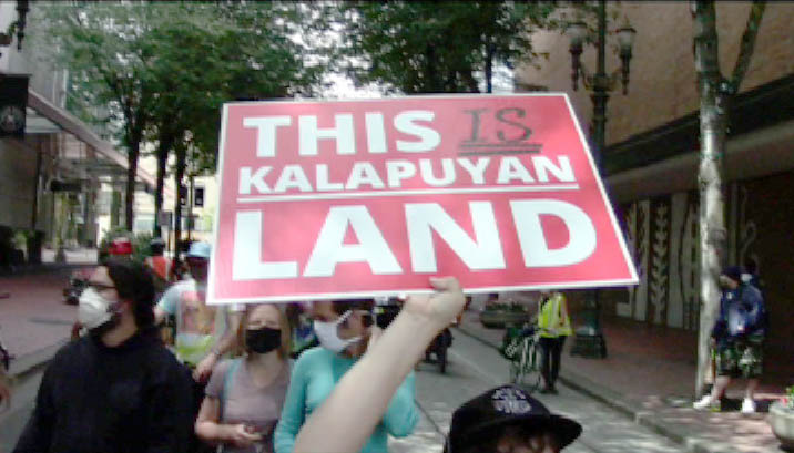 [Protest sign: This is Kalapuyan Land]